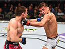 DALLAS, TX - MARCH 14:  (L-R) Ryan Benoit lands a punch to the chin of Sergio Pettis in their flyweight bout during the UFC 185 event at the American Airlines Center on March 14, 2015 in Dallas, Texas. (Photo by Josh Hedges/Zuffa LLC/Zuffa LLC via Getty Images)