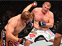 DALLAS, TX - MARCH 14:  (R-L) Josh Copeland and Jared Rosholt exchange punches in their heavyweight bout during the UFC 185 event at the American Airlines Center on March 14, 2015 in Dallas, Texas. (Photo by Josh Hedges/Zuffa LLC/Zuffa LLC via Getty Images)