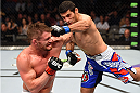 DALLAS, TX - MARCH 14:  (R-L) Beneil Dariush throws a flying superman punch against Daron Cruickshank in their lightweight bout during the UFC 185 event at the American Airlines Center on March 14, 2015 in Dallas, Texas. (Photo by Josh Hedges/Zuffa LLC/Zuffa LLC via Getty Images)