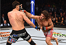 DALLAS, TX - MARCH 14:  (R-L) Elias Theodorou punches at Roger Narvaez in their middleweight bout during the UFC 185 event at the American Airlines Center on March 14, 2015 in Dallas, Texas. (Photo by Josh Hedges/Zuffa LLC/Zuffa LLC via Getty Images)