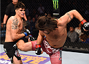 DALLAS, TX - MARCH 14:  (R-L) Elias Theodorou lands a kick to the body of Roger Narvaez in their middleweight bout during the UFC 185 event at the American Airlines Center on March 14, 2015 in Dallas, Texas. (Photo by Josh Hedges/Zuffa LLC/Zuffa LLC via Getty Images)