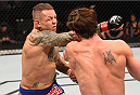 DALLAS, TX - MARCH 14:  (L-R) Ross Pearson punches Sam Stout in their lightweight bout during the UFC 185 event at the American Airlines Center on March 14, 2015 in Dallas, Texas. (Photo by Josh Hedges/Zuffa LLC/Zuffa LLC via Getty Images)
