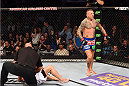DALLAS, TX - MARCH 14:  (R-L) Ross Pearson celebrates after defeating Sam Stout in their lightweight bout during the UFC 185 event at the American Airlines Center on March 14, 2015 in Dallas, Texas. (Photo by Josh Hedges/Zuffa LLC/Zuffa LLC via Getty Images)