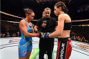 DALLAS, TX - MARCH 14:  (L-R) UFC women's strawweight champion Carla Esparza and Joanna Jedrzejczyk touch gloves before their UFC women's strawweight championship bout during the UFC 185 event at the American Airlines Center on March 14, 2015 in Dallas, Texas. (Photo by Josh Hedges/Zuffa LLC/Zuffa LLC via Getty Images)
