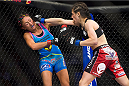 DALLAS, TX - MARCH 14:  Joanna Jedrzejczyk throws a punch at Carla Esparza during UFC 185 at the American Airlines Center on March 14, 2015 in Dallas, Texas. (Photo by Cooper Neill/Zuffa LLC/Zuffa LLC via Getty Images)