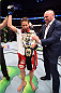 DALLAS, TX - MARCH 14:  (R-L) UFC President Dana White gives Joanna Jedrzejczyk the UFC women's strawweight championship belt after defeating Carla Esparza by TKO during the UFC 185 event at the American Airlines Center on March 14, 2015 in Dallas, Texas. (Photo by Josh Hedges/Zuffa LLC/Zuffa LLC via Getty Images)