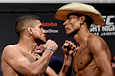 RIO DE JANEIRO, BRAZIL - MARCH 20: Gilbert Durinho (L) of Brazil and Alex Oliveira of Brazil face off during the UFC Fight Night Weigh-ins at Maracanazinho  on March 20, 2015 in Rio de Janeiro, Brazil.  (Photo by Buda Mendes/Zuffa LLC/Zuffa LLC via Getty Images)
