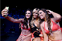 RIO DE JANEIRO, BRAZIL - MARCH 21: (L-R) UFC Octagon Girls Camila Oliveira, Jhenny Andrade and Luciana Andrade take a selfie during the UFC Fight Night event at Maracanazinho Gymnasium on March 21, 2015 in Rio de Janeiro, Brazil. (Photo by Buda Mendes/Zuffa LLC/Zuffa LLC via Getty Images)