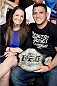 RIO DE JANEIRO, BRAZIL - MARCH 21: Lightweight Champion Rafael dos Anjos of Brazil and his wife Cristiane dos Anjos pose for the media during the UFC Fight Night at Maracanazinho Gymnasium on March 21, 2015 in Rio de Janeiro, Brazil. (Photo by Buda Mendes/Zuffa LLC/Zuffa LLC via Getty Images)