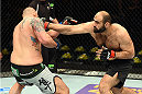 FAIRFAX, VA - APRIL 04:   (R-L) Shamil Abdurakhimov of Russia punches Timothy Johnson in their heavyweight fight during the UFC Fight Night event at the Patriot Center on April 4, 2015 in Fairfax, Virginia. (Photo by Josh Hedges/Zuffa LLC/Zuffa LLC via Getty Images)