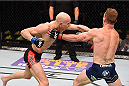 FAIRFAX, VA - APRIL 04:   (L-R) Alexander Yakovlev punches Gray Maynard in their lightweight fight during the UFC Fight Night event at the Patriot Center on April 4, 2015 in Fairfax, Virginia. (Photo by Josh Hedges/Zuffa LLC/Zuffa LLC via Getty Images)