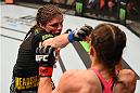 FAIRFAX, VA - APRIL 04:   (L-R) Lauren Murphy punches Liz Carmouche in their women's bantamweight fight during the UFC Fight Night event at the Patriot Center on April 4, 2015 in Fairfax, Virginia. (Photo by Josh Hedges/Zuffa LLC/Zuffa LLC via Getty Images)