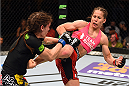 FAIRFAX, VA - APRIL 04:  (R-L) Liz Carmouche kicks Lauren Murphy in their women's bantamweight fight during the UFC Fight Night event at the Patriot Center on April 4, 2015 in Fairfax, Virginia. (Photo by Josh Hedges/Zuffa LLC/Zuffa LLC via Getty Images)