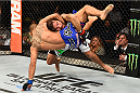 FAIRFAX, VA - APRIL 04:  (R-L) Clay Guida takes down Robbie Peralta in their featherweight fight during the UFC Fight Night event at the Patriot Center on April 4, 2015 in Fairfax, Virginia. (Photo by Josh Hedges/Zuffa LLC/Zuffa LLC via Getty Images)