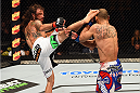 FAIRFAX, VA - APRIL 04:  (L-R) Clay Guida kicks Robbie Peralta in their featherweight fight during the UFC Fight Night event at the Patriot Center on April 4, 2015 in Fairfax, Virginia. (Photo by Josh Hedges/Zuffa LLC/Zuffa LLC via Getty Images)