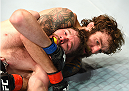 FAIRFAX, VA - APRIL 04:  (R-L) Michael Chiesa attempts a submission against Mitch Clarke in their lightweight fight during the UFC Fight Night event at the Patriot Center on April 4, 2015 in Fairfax, Virginia. (Photo by Josh Hedges/Zuffa LLC/Zuffa LLC via Getty Images)
