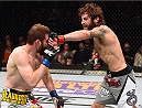 FAIRFAX, VA - APRIL 04:  (R-L) Michael Chiesa punches Mitch Clarke in their lightweight fight during the UFC Fight Night event at the Patriot Center on April 4, 2015 in Fairfax, Virginia. (Photo by Josh Hedges/Zuffa LLC/Zuffa LLC via Getty Images)