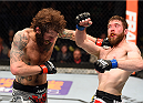 FAIRFAX, VA - APRIL 04:  (L-R) Michael Chiesa punches Mitch Clarke in their lightweight fight during the UFC Fight Night event at the Patriot Center on April 4, 2015 in Fairfax, Virginia. (Photo by Josh Hedges/Zuffa LLC/Zuffa LLC via Getty Images)