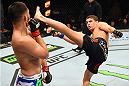 FAIRFAX, VA - APRIL 04:  (R-L) Al Iaquinta throws a kick against Jorge Masvidal in their lightweight fight during the UFC Fight Night event at the Patriot Center on April 4, 2015 in Fairfax, Virginia. (Photo by Josh Hedges/Zuffa LLC/Zuffa LLC via Getty Images)