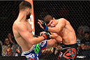 FAIRFAX, VA - APRIL 04:  (L-R) Jorge Masvidal lands a kick against Al Iaquinta in their lightweight fight during the UFC Fight Night event at the Patriot Center on April 4, 2015 in Fairfax, Virginia. (Photo by Josh Hedges/Zuffa LLC/Zuffa LLC via Getty Images)