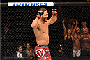FAIRFAX, VA - APRIL 04:  Chad Mendes celebrates after defeating Ricardo Lamas in their featherweight fight during the UFC Fight Night event at the Patriot Center on April 4, 2015 in Fairfax, Virginia. (Photo by Josh Hedges/Zuffa LLC/Zuffa LLC via Getty Images)