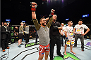 FAIRFAX, VA - APRIL 04:  (L-R) Chad Mendes celebrates after defeating Ricardo Lamas in their featherweight fight during the UFC Fight Night event at the Patriot Center on April 4, 2015 in Fairfax, Virginia. (Photo by Josh Hedges/Zuffa LLC/Zuffa LLC via Getty Images)