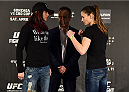 KRAKOW, POLAND - APRIL 08:  Joanne Calderwood of Scotland (L) and Maryna Moroz of Croatia face off for the media during the UFC Fight Night Ultimate Media Day inside the TAURON Arena on April 8, 2015 in Krakow, Poland. (Photo by Jeff Bottari/Zuffa LLC/Zuffa LLC via Getty Images)