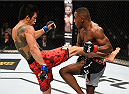KRAKOW, POLAND - APRIL 11:  (L-R) Rocky Lee of Taiwan kicks Taylor Lapilus of France in their featherweight fight during the UFC Fight Night event at the Tauron Arena on April 11, 2015 in Krakow, Poland. (Photo by Jeff Bottari/Zuffa LLC/Zuffa LLC via Getty Images)