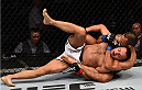 KRAKOW, POLAND - APRIL 11:  (R-L) Yaotzin Meza of the United States attempts a rear choke submission against Damian Stasiak of Poland in their featherweight fight during the UFC Fight Night event at the Tauron Arena on April 11, 2015 in Krakow, Poland. (Photo by Jeff Bottari/Zuffa LLC/Zuffa LLC via Getty Images)