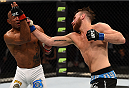 KRAKOW, POLAND - APRIL 11:  (R-L) Mickael Lebout of France punches Sergio Moraes of Brazil in their welterweight fight during the UFC Fight Night event at the Tauron Arena on April 11, 2015 in Krakow, Poland. (Photo by Jeff Bottari/Zuffa LLC/Zuffa LLC via Getty Images)