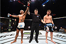 KRAKOW, POLAND - APRIL 11:  Sergio Moraes (L) of Brazil celebrates after his decision victory over Mickael Lebout of France in their welterweight fight during the UFC Fight Night event at the Tauron Arena on April 11, 2015 in Krakow, Poland. (Photo by Jeff Bottari/Zuffa LLC/Zuffa LLC via Getty Images)