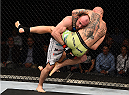 KRAKOW, POLAND - APRIL 11:  (L-R) Bartosz Fabinski of Poland takes down Garreth McLellan of South Africa in their middleweight fight during the UFC Fight Night event at the Tauron Arena on April 11, 2015 in Krakow, Poland. (Photo by Jeff Bottari/Zuffa LLC/Zuffa LLC via Getty Images)