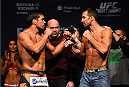 NEWARK, NJ - APRIL 17:  (L-R) Lyoto 'The Dragon' Machida of Brazil and Luke Rockhold face off during the UFC Fight Night weigh-in event at the Prudential Center on April 17, 2015 in Newark, New Jersey. (Photo by Jeff Bottari/Zuffa LLC/Zuffa LLC via Getty Images)