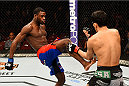 NEWARK, NJ - APRIL 18:  Aljamain Sterling (L) kicks Takeya Mizugaki of Japan in their bantamweight bout during the UFC Fight Night event at Prudential Center on April 18, 2015 in Newark, New Jersey.  (Photo by Josh Hedges/Zuffa LLC/Zuffa LLC via Getty Images)