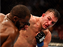 NEWARK, NJ - APRIL 18:  Gian Villante punches Corey Anderson in their light heavyweight bout during the UFC Fight Night event at Prudential Center on April 18, 2015 in Newark, New Jersey.  (Photo by Josh Hedges/Zuffa LLC/Zuffa LLC via Getty Images)