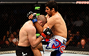 NEWARK, NJ - APRIL 18:  Beneil Dariush (R) of Iran knees Jim Miller in their lightweight bout during the UFC Fight Night event at Prudential Center on April 18, 2015 in Newark, New Jersey.  (Photo by Josh Hedges/Zuffa LLC/Zuffa LLC via Getty Images)