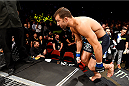 NEWARK, NJ - APRIL 18:  Luke Rockhold climbs into the octagon for his middleweight bout against Lyoto Machida of Brazil during the UFC Fight Night event at Prudential Center on April 18, 2015 in Newark, New Jersey.  (Photo by Josh Hedges/Zuffa LLC/Zuffa LLC via Getty Images)