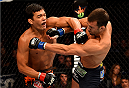 NEWARK, NJ - APRIL 18:  Luke Rockhold and Lyoto Machida of Brazil exchange blows in their middleweight bout during the UFC Fight Night event at Prudential Center on April 18, 2015 in Newark, New Jersey.  (Photo by Josh Hedges/Zuffa LLC/Zuffa LLC via Getty Images)