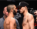 MONTREAL, QC - APRIL 24:   (L-R) Opponents John Makdessi of Canada and Shane Campbell of Canada face off during the UFC 186 weigh-in at Metropolis on April 24, 2015 in Montreal, Quebec, Canada. (Photo by Josh Hedges/Zuffa LLC/Zuffa LLC via Getty Images)