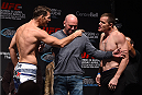 MONTREAL, QC - APRIL 24:   (L-R) Opponents Michael Bisping of England and CB Dolloway of the United States face off during the UFC 186 weigh-in at Metropolis on April 24, 2015 in Montreal, Quebec, Canada. (Photo by Josh Hedges/Zuffa LLC/Zuffa LLC via Getty Images)