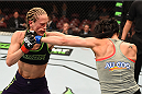 MONTREAL, QC - APRIL 25:   (L-R) Jessica Rakoczy and Valerie Letourneau of Canada trade punches in their women's strawweight bout during the UFC 186 event at the Bell Centre on April 25, 2015 in Montreal, Quebec, Canada. (Photo by Josh Hedges/Zuffa LLC/Zuffa LLC via Getty Images)