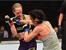 MONTREAL, QC - APRIL 25:   (R-L) Valerie Letourneau punches Jessica Rakoczy in their women's strawweight bout during the UFC 186 event at the Bell Centre on April 25, 2015 in Montreal, Quebec, Canada. (Photo by Josh Hedges/Zuffa LLC/Zuffa LLC via Getty Images)