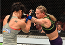 MONTREAL, QC - APRIL 25:   (R-L) Jessica Rakoczy punches Valerie Letourneau of Canada in their women's strawweight bout during the UFC 186 event at the Bell Centre on April 25, 2015 in Montreal, Quebec, Canada. (Photo by Josh Hedges/Zuffa LLC/Zuffa LLC via Getty Images)