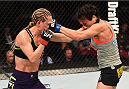 MONTREAL, QC - APRIL 25:   (R-L) Valerie Letourneau of Canada and Jessica Rakoczy trade punches in their women's strawweight bout during the UFC 186 event at the Bell Centre on April 25, 2015 in Montreal, Quebec, Canada. (Photo by Josh Hedges/Zuffa LLC/Zuffa LLC via Getty Images)
