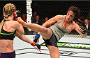 MONTREAL, QC - APRIL 25:   (R-L) Valerie Letourneau of Canada kicks Jessica Rakoczy in their women's strawweight bout during the UFC 186 event at the Bell Centre on April 25, 2015 in Montreal, Quebec, Canada. (Photo by Josh Hedges/Zuffa LLC/Zuffa LLC via Getty Images)