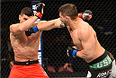 MONTREAL, QC - APRIL 25:   (R-L) Chris Clements of Canada punches Nordine Taleb of Canada in their welterweight bout during the UFC 186 event at the Bell Centre on April 25, 2015 in Montreal, Quebec, Canada. (Photo by Josh Hedges/Zuffa LLC/Zuffa LLC via Getty Images)