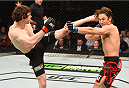 MONTREAL, QC - APRIL 25:   (L-R) Olivier Aubin-Mercier of Canada kicks David Michaud of the United States in their lightweight bout during the UFC 186 event at the Bell Centre on April 25, 2015 in Montreal, Quebec, Canada. (Photo by Josh Hedges/Zuffa LLC/Zuffa LLC via Getty Images)