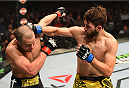 MONTREAL, QC - APRIL 25:   (R-L) Bryan Barberena of the United States punches Chad Laprise of Canada in their lightweight bout during the UFC 186 event at the Bell Centre on April 25, 2015 in Montreal, Quebec, Canada. (Photo by Josh Hedges/Zuffa LLC/Zuffa LLC via Getty Images)