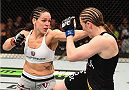 MONTREAL, QC - APRIL 25:   (L-R) Alexis Davis of Canada punches Sarah Kaufman of Canada in their women's bantamweight bout during the UFC 186 event at the Bell Centre on April 25, 2015 in Montreal, Quebec, Canada. (Photo by Josh Hedges/Zuffa LLC/Zuffa LLC via Getty Images)