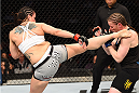 MONTREAL, QC - APRIL 25:   (L-R) Alexis Davis of Canada kicks Sarah Kaufman of Canada in their women's bantamweight bout during the UFC 186 event at the Bell Centre on April 25, 2015 in Montreal, Quebec, Canada. (Photo by Josh Hedges/Zuffa LLC/Zuffa LLC via Getty Images)